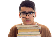 Young man in glasses with books Stock Photography