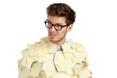 Young man with a glasses covered with yellow stickers Royalty Free Stock Photo