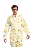 Young man with a glasses covered with yellow sticky notes Stock Image