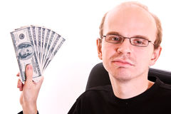 Young man in glasses with dollar banknotes Royalty Free Stock Photography