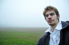 Young man with glasses in field Stock Photos