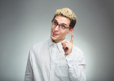 Young man in glasses with a funny expression on his face and thu Stock Images