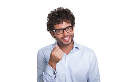 Young man with glasses gesturing with hand Stock Images