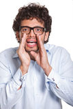 Young man with glasses gesturing with hands Royalty Free Stock Images
