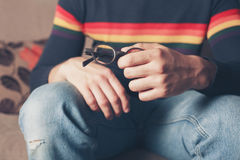 Young man with glasses in his hand Royalty Free Stock Image