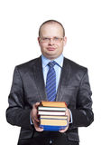 A young man in glasses holding books Royalty Free Stock Photo