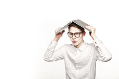 Young man in glasses with laptop with emotion concept new building Stock Photo
