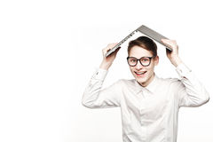 Young man in glasses with laptop with emotion concept new buildingg Stock Photo