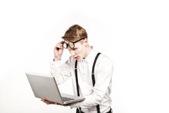 Young man in glasses with laptop with emotion Royalty Free Stock Images