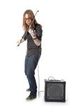 Young man with glasses plays electric violin standing in studio Stock Photography