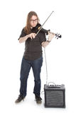 Young man with glasses plays electric violin standing in studio Stock Photo
