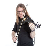 Young man with glasses plays electric violin in studio Royalty Free Stock Images