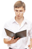 Young man in glasses reading book Stock Photo