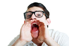 Young man in glasses screaming. Closeup portrait of a young man in glasses screaming out loud on a white background Stock Images
