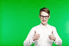 Young man in glasses shows thumbs up Royalty Free Stock Photos