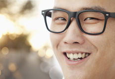 Young man with glasses smiling close-up, portrait Royalty Free Stock Photos