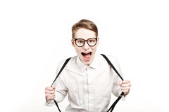 Young man in glasses surprises and shock screaming Stock Image