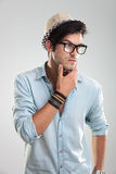 Young man with glasses thinking Royalty Free Stock Photo