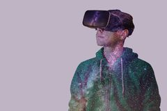 Young man with glasses of virtual reality on a background of northen lights Stock Images