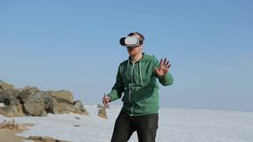 A young man with glasses virtual reality.Coast in the spring stock footage