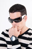 Young man with glasses. And wach thinking Royalty Free Stock Images