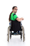 Young man with glasses in a wheelchairfrom the back Royalty Free Stock Photography