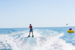 Young man glides on water skiing on the waves on the sea, ocean. Healthy lifestyle. Positive human emotions, feelings,. Joy Stock Photos