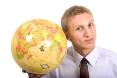 Young man and globus. Young man holding globus made of puzzles Royalty Free Stock Photos