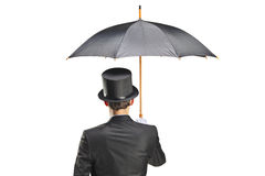 Young man with gloves holding an umbrella. Isolated on white background Stock Photos
