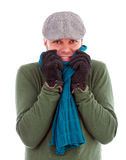 Young man with gloves and scarf  shivering  from cold Royalty Free Stock Image