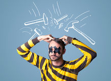 Young man with glued eye and hammer marks Royalty Free Stock Photo