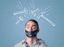 Young man with glued mouth and beating hammer marks Royalty Free Stock Image