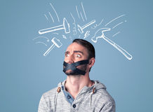 Young man with glued mouth and beating hammer marks Stock Images