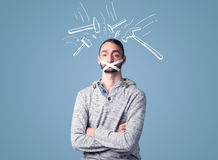 Young man with glued mouth and beating hammer marks Royalty Free Stock Images