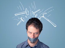 Young man with glued mouth and beating hammer marks Stock Photo