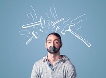 Young man with glued mouth and beating hammer marks Stock Photos