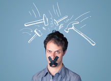 Young man with glued mouth and beating hammer marks Stock Image