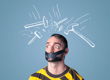 Young man with glued mouth and beating hammer marks Stock Photography