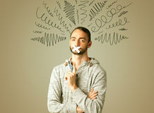 Young man with glued mouth and curly lines Royalty Free Stock Image