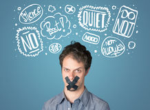 Young man with glued mouth and thought clouds Stock Photography