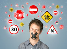 Young man with glued mouth and traffic signals Stock Photos