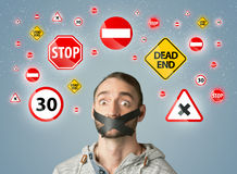 Young man with glued mouth and traffic signals Stock Image