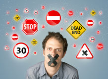 Young man with glued mouth and traffic signals Stock Photography