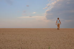Young man go up in sand desert Royalty Free Stock Images
