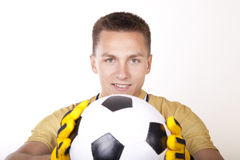 Young man goalkeeper. Holding a ball Royalty Free Stock Photos