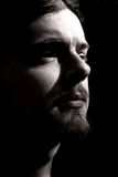 Young Man with Goatee, low-key. A low key shot of a young man with a goatee Royalty Free Stock Image