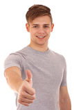 Young man going thumb up. Isolated over white background Royalty Free Stock Images