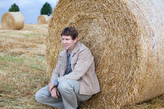 Young man on golden hay straw field in Germany Stock Photos