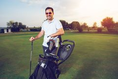 Young man with a golf bag. Young man with a new golf bag stock image