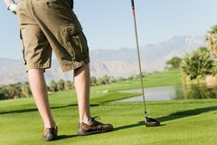 Young Man With Golf Club Stock Photography